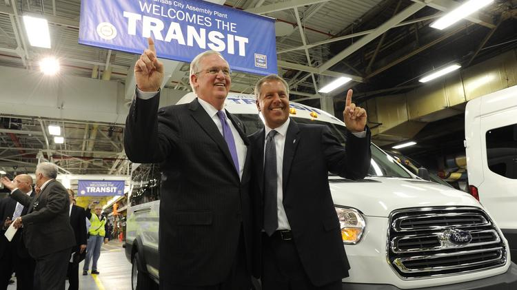 Missouri Gov. Jay Nixon (left) and Joe Hinrichs, Ford Motor Co.'s president of the Americas, celebrate after driving the first Ford Transit Van off the assembly line at the Ford Claycomo Plant.