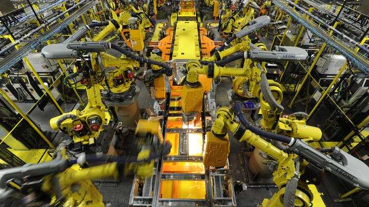 Robotic arms spot welds on the chassis of a Ford Transit Van at the Ford Claycomo Assembly Plant.