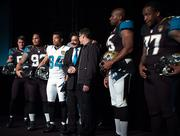 Jaguars owner Shahid Khan shakes hands with Nike's Global Vice President and Design Director for Nike Football Todd Van Horne, during the Jaguars team press conference introducing the team's new uniforms.
