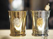 The $2000 mint julep cup, left, and $1000 mint julep cup, right, will be sold to charity by Brown-Forman.