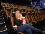 Colette Wharton, asset manager for Goodman Realty Group, sits in the Regal IMAX theater at Winrock.