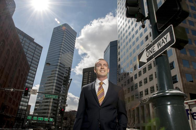 Judson Robertson, director at Stream Realty Partners, stands on the corner of 17th Street and Tremont Place. Brokers are trying to sell tenants on the idea of going back to the Broadway and 17th office corridor where rates are more reasonable and there are bigger blocks of space available.