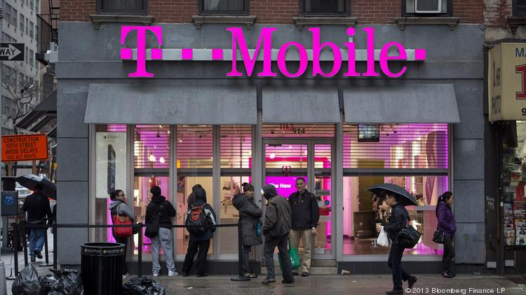 Customers line up at T-Mobile USA Inc. retail location in New York.