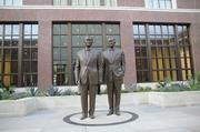 Bronze statues of father-and-son U.S. Presidents 41 and 43 greet visitors of the museum in an upstairs patio.