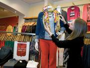 Stylist Taylor Latvala puts the finishing touches on a display Monday Jan. 28, 2013 at the Hot Mama shop in Edina, MN.