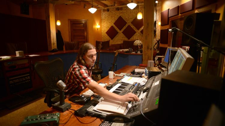 Audio Post-Production Producer Joe Mechtenberg works in the Pixel Farm sound studio, which will move with the company across the street this summer.