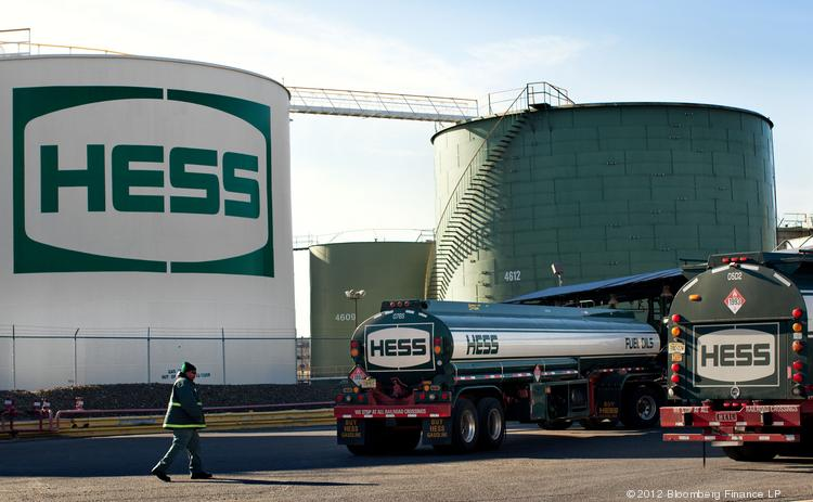 A Hess Corp. truck pulls into a fueling station at the Hess petroleum terminal in Bogota, N.J. The company doubled its quarterly profits, aided by asset sales.
