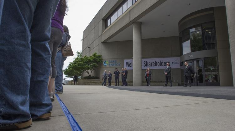 A blue taped line denotes the division of public space and Duke Energy's private property in front of their annual shareholders meeting.