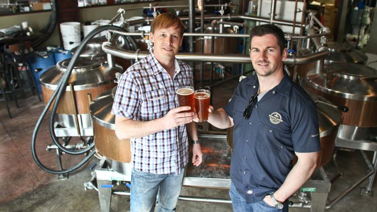Gavin Meyers, left, and Tim Ward are toasting their expansion of North High Brewing.