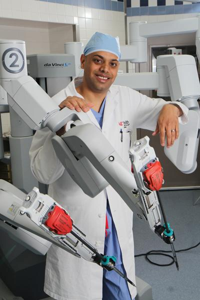 Dr. Tayyab Diwan, a general surgeon at UC Health, has performed about 100 surgeries with the  da Vinci surgical robot. UC Health has two of the systems, which cost about $1.5 million each.