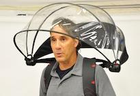 Alan Kaufman, founder and CEO of Nubrella, wears the latest version of the product, a hands-free, wind-resistant umbrella that's worn like a backpack and functions like a hood.