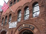 Banners on the Boylston Street fire station in Boston's Back Bay remembered Marathon bombing victims as the street reopened to the public.