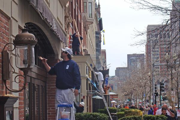 Workers cleaned, scraped, painted and otherwise restored Boylston Street restaurant store fronts and patios – Abe & Louie's and Atlantic Fish – damaged in the Marathon Monday bombing attack.