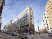 A city grant will help outfit retail space on the ground level of the Posner Building, which is being rehabbed into apartments.