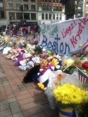 Memorials set up along barricades that had blocked Boylston Street were moved to Copley Square by the morning of the street's reopening.