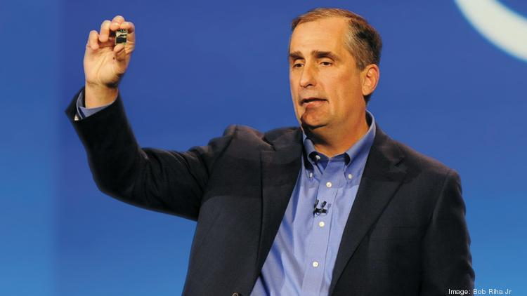 CEO Brian Krzanich holds Intel's Edison, a tiny general computing platform with built-in wireless. The product is expected to launch this summer and allow developers to create wearable devices.