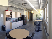 SfunCube's space includes multiple kitchens and exposed building materials — concrete, brick and timber.