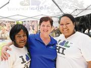 The Aloha Harvest team, from left, Serenia Smalls-Bonds, food donation coordinator; Kuulei Williams, executive director; and Mele Pepa, administrative assistant and agency coordinator; at Aloha Harvest's third annual agency fair and food drive at Tamarind Park at Bishop Square. Aloha Harvest, along with partnering nonprofit agencies, were promoting awareness of community services.