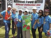 A team of real estate agents from Kahala Associates volunteered their time collecting canned food and monetary donations at the Waiokeola Congregational Church in Kahala for the 25th annual Hawaii Foodbank drive. From left, John Elliott, Chris Friese, Ida Elliott, Boo Young Lee, Renee Hampton, Myra Brandt and Yuki Takenaka.