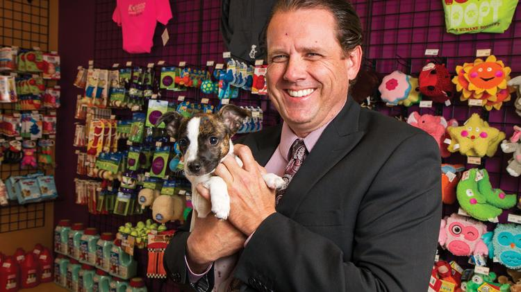Mark Eby, president and CEO of the Kansas Humane Society, with Smurfette, a 3-month-old terrier mix.