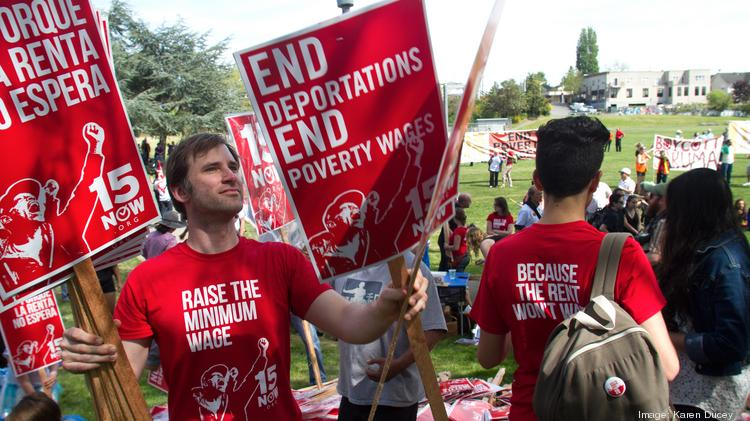Bryan Watson prepares for a march from Judkins Park on Capitol Hill to Westlake Center for a rally for immigration and labor rights in Seattle.