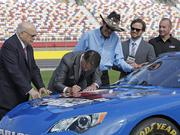 """Gov. Pat McCrory signs a proclamation declaring May as """"Motorsports Month"""" in North Carolina."""