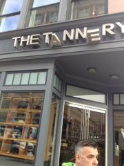 One of the bomb blasts knocked askew the sign at The Tannery.