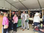 Kentucky Oaks Day attendees perused the Kentucky Derby merchandise for sale at G.O. Ministries Inc.'s and The Game's pop-up store.