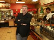 Papa Murphy's franchise owner Jim Lovelace hangs at Camas location. The chain went public Friday and, around late morning, traded about 6 percent higher than its opening price.