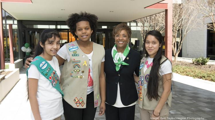 Faye Fields, incoming president of Girl Scouts Nation's Capital, with three of more than 89,000 members she'll be leading this fall.