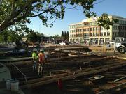 Work continues at a town square in the city of Roseville's downtown. A dedication is planned for this summer. The city also is making plans to make the square a continuously active place during the daytime, with events and activities planned during the week and on weekends.