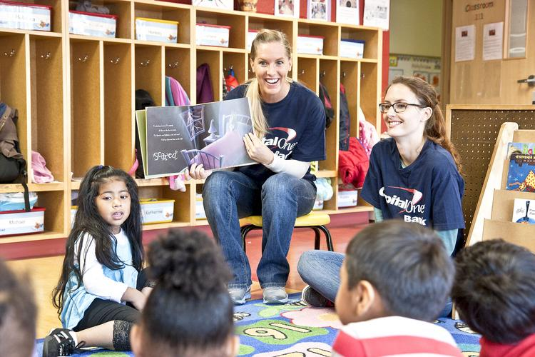 As part of the company's One Week of Service, Capital One Bank employees read to children at a head start center in Arlington.