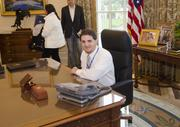 DBJ Staff Writer Nicholas Sakelaris experiences what it feels like to sit at the president's desk in the George W. Bush Center's re-creation of the Oval Office.