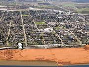 The Kimberly-Clark mill site on Everett's waterfront went back on the market in April after a proposed sale to Foss Maritime fell through. Talks are continuing.