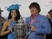 Jason Dufner, the 2013 PGA Championship winner, and his wife, Amanda Boyd, held the Wanamaker Trophy at Churchill Downs on Kentucky Derby Day.