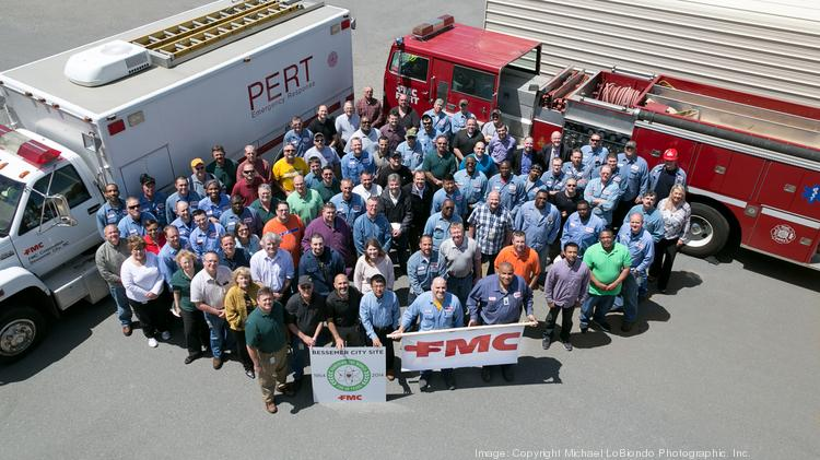 FMC Minerals employees pose with emergency vehicles at the Bessemer City facility.