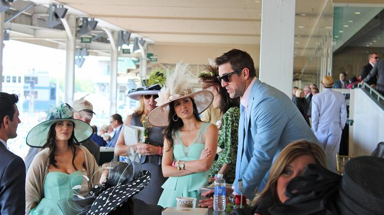 Green Bay Packers quarterback Aaron Rodgers chatted in the Turf Terrace at Churchill Downs.