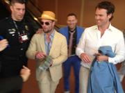 Denver Broncos wide receiver Wes Welker hands out $100 bills after winning big at the Kentucky Derby.
