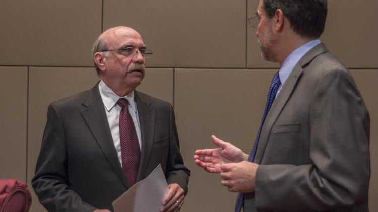 Charlotte Mayor Dan Clodfelter speaks with City Attorney Bob Hageman last month during a council meeting.