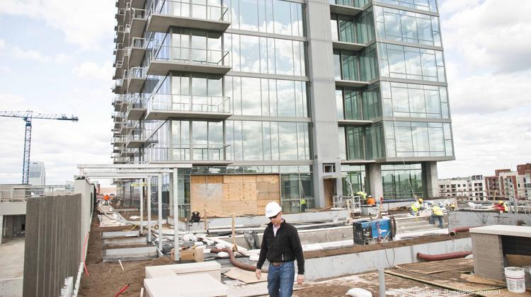 Ray Hensler walks on a terrace at the new Twelve Twelve high-rise condominium.