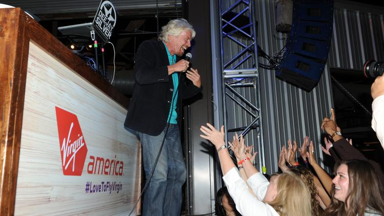 Virgin America founder Richard Branson talks to the crowd Monday night at a party at the Rustic in Dallas to support Virgin America getting two gates at Dallas Love Field.