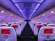 The cabin of a Virgin America jet has mood lighting, wireless internet and live television.