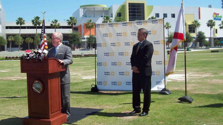 Tampa Mayor Bob Buckhorn and Craig Cowden, chief network officer and senior vice president of enterprise services for Bright House Networks, announce upcoming WiFi service in downtown waterfront parks.
