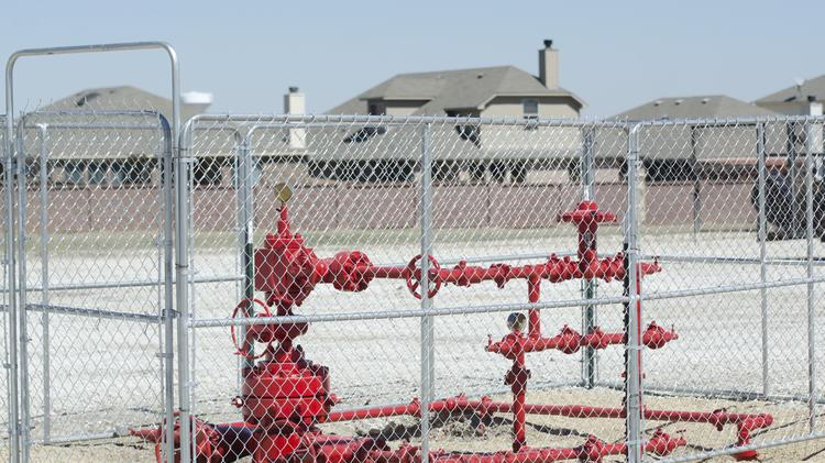 Residents in Denton gathered signatures for a petition to ban fracking in Denton after Barnett Shale wells like this one were drilled within a few hundred feet of homes.