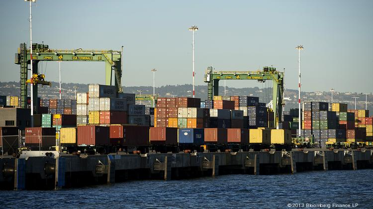 Shipping containers sit stacked at the Port of Oakland in Oakland.  The California trade market continued its steady lead above overall U.S. exports in March. One highlight was manufactured exports totaling $10.3 billion, up from $9.2 billion in March 2013.