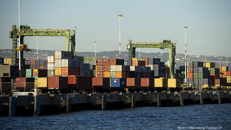 Shipping containers sit stacked at the Port of Oakland in Oakland, California, U.S., on Thursday, June 20, 2013. The U.S. Commerce Department's Bureau of Economic Analysis is scheduled to release gross domestic product (GDP) figures on June 26. Photographer: David Paul Morris/Bloomberg