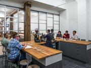 Counter Culture Coffee employees prepare for a coffee tasting at the company's newest training center in New York.
