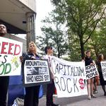 Few protesters on streets as Bank of America faces shareholders (PHOTOS)