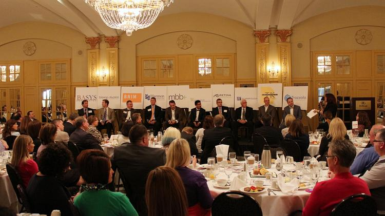 Leaders at the Greater Kansas City Chamber of Commerce's Top 10 Small Businesses of 2014 participate in a question and answer session.