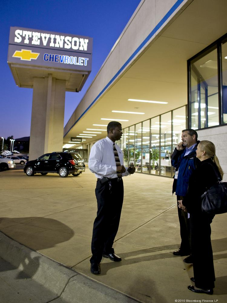 Customers speak with Hadyn A. Roberts, Internet sales manager, about buying a vehicle at the Stevinson Chevrolet West dealership in Lakewood.